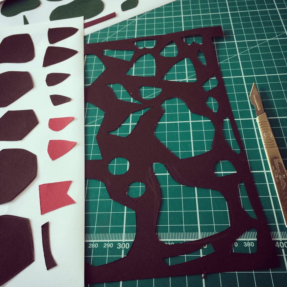 PROCESS: Original component parts of the fox illustration cut from paper, with options on different shapes to play around with...