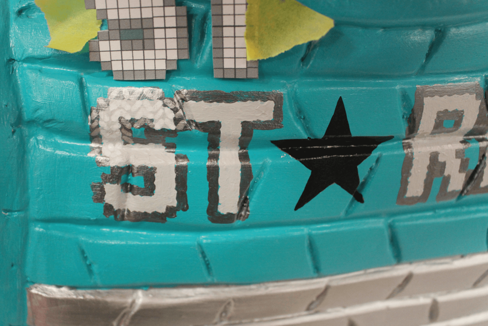 Once painted, the lettering was worked over with Posca pens to achieve a subtle knitted effect.