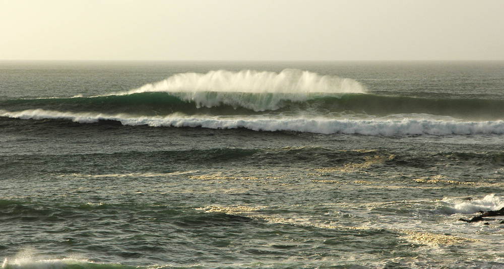Strong off shore winds grooming the waves at Little Fistral just before sunset.