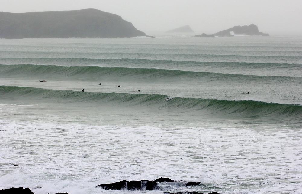 A set of clean defined waves rolls into Fistral beach in Newquay.
