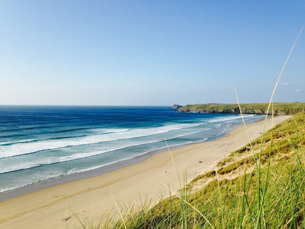 surfing at perranporth beach