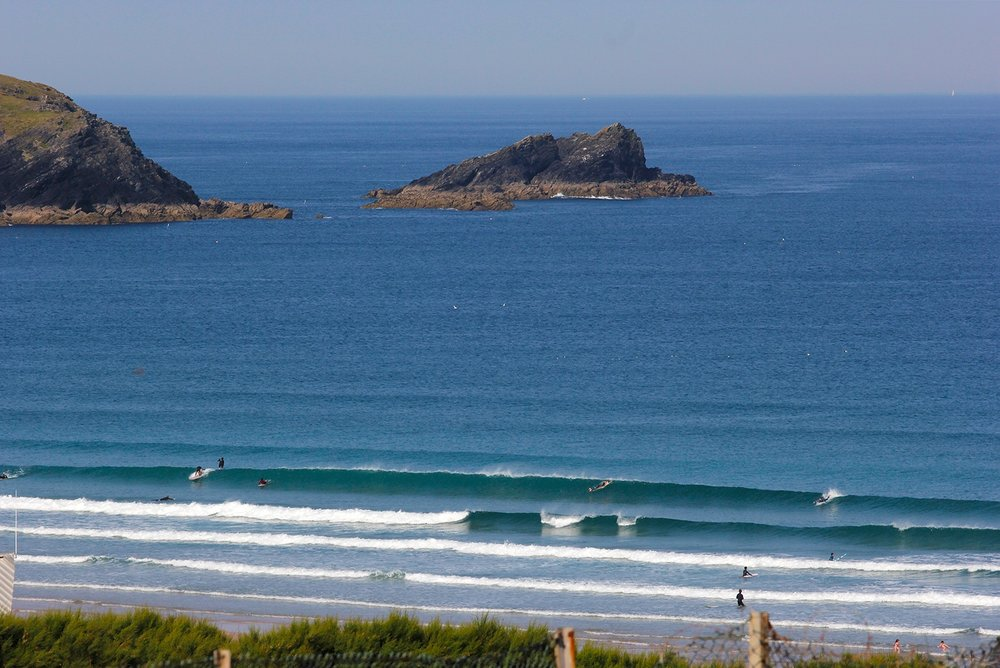 blue waves breaking at fistral beach newquay cornwall