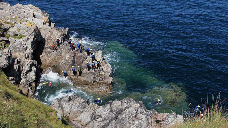 Cornish Wave Coasteering sessions all have a minimum of two guides