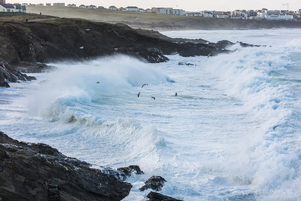 large white water waves breaking on the rocks at little fistral beach in newquay, cornwall