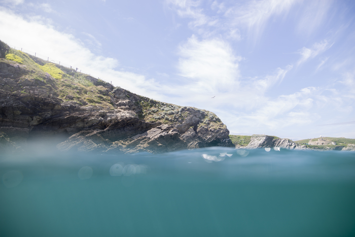water shot showing coasteering cliffs in newquay cornwall