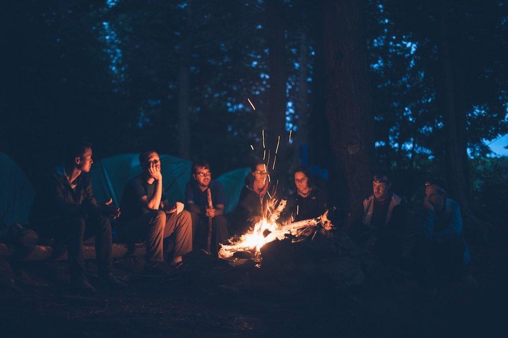 Friends enjoying the camp fire Wilderness & adventure