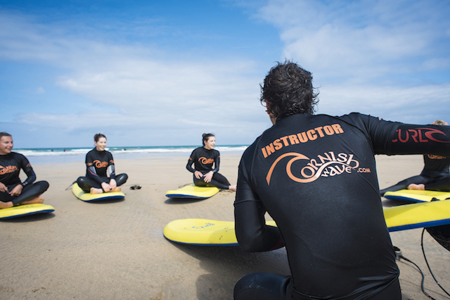 surf coach delivering a surf lesson on fistral beach, newquay