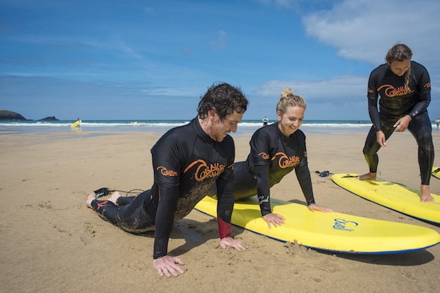 surf coach and students learning to surf