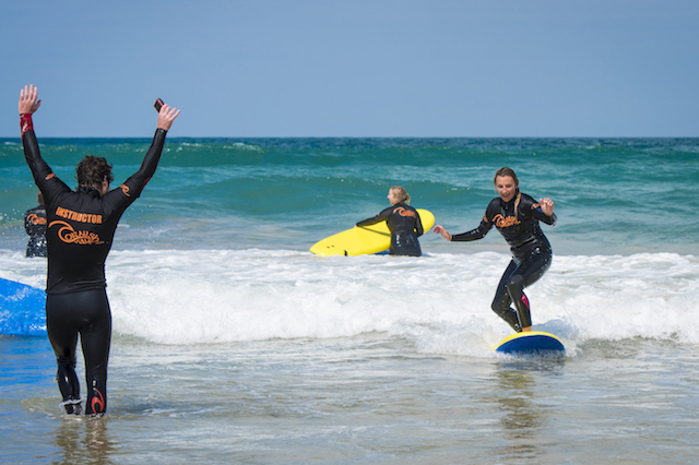 surf coach celebrating success for student