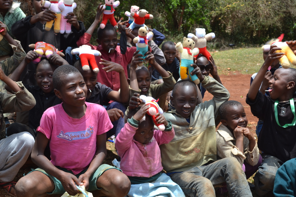 Children at the IDP camp, excited about the toys given to them by the team.