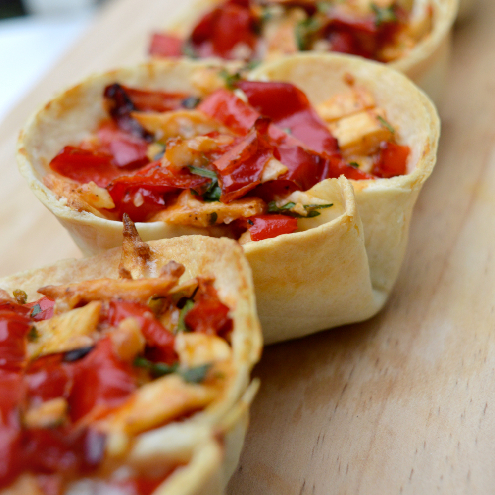 Pita cups filled with paprika and feta cheese  Vegetarian / contains eggs