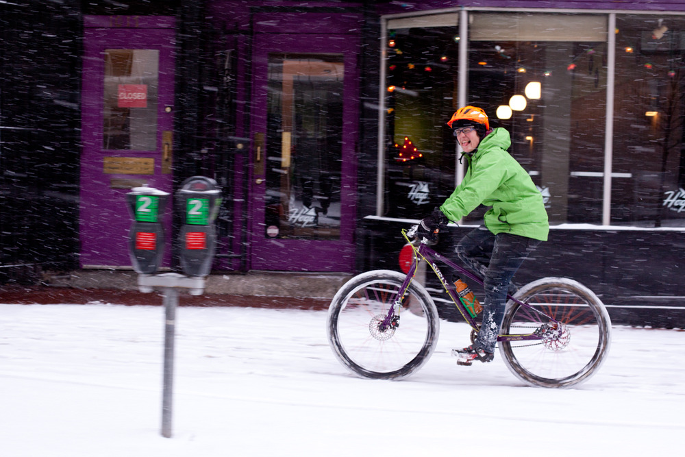 "Kate and her ""baby fat bike,"" a Surly Troll. ""Riding the unplowed Met Branch Trail is the Troll's dream."""
