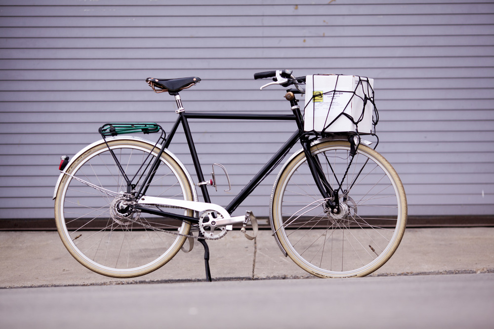A.N.T Boston Roadster featuring handmade frame and racks. John often delivers small orders to bars and restaurant by bike.