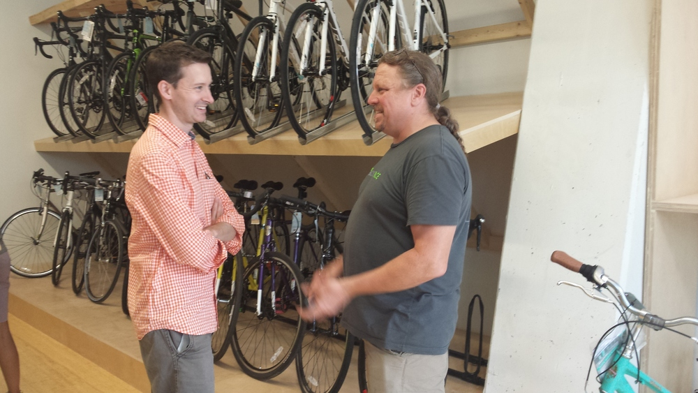 Ward 6 Councilman Charles Allen, left, with BicycleSPACE co-owner Phil Koopman, gesturing so enthusiastically his hands are blurry. We love how a gorgeous Celeste Bianchi Milano Dama photobombs at right.