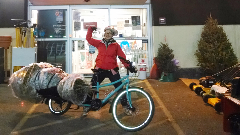 Friend of the Space, Christina, uses her Xtracycle for everything from Christmas trees to kegs.