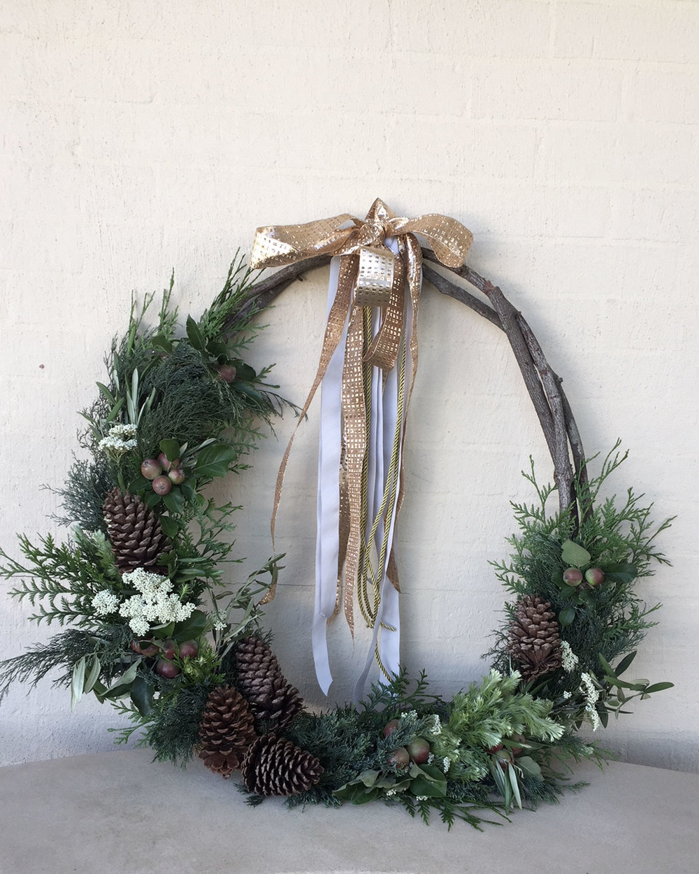 Large Classic Wreath featuring natural green foliage, rice flower, miniature apples and pinecones from $140