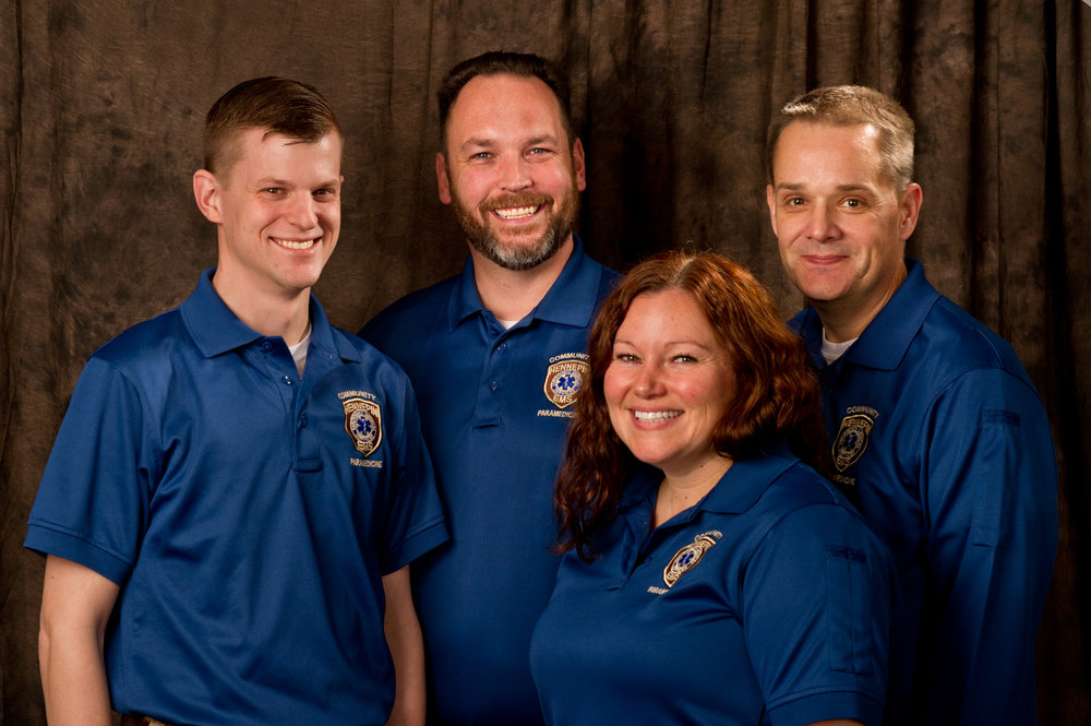 Community Paramedics  Dave Johnson ,  Mike Molitor , Deputy Chief  Amber Brown , and  Dennis Combs