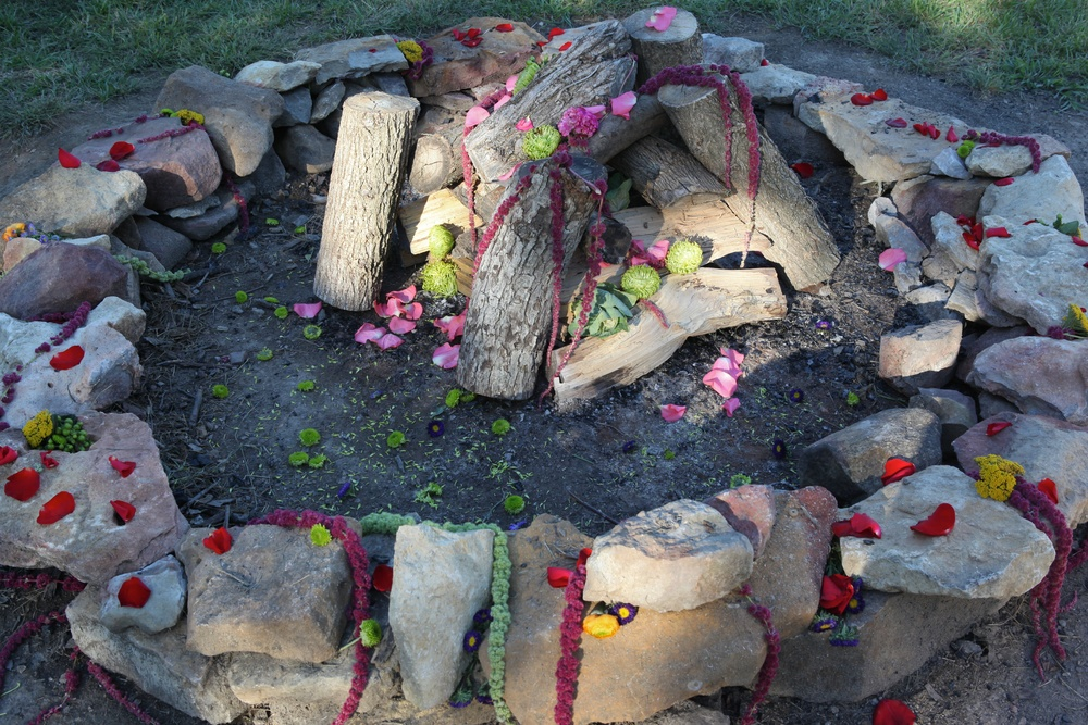 Firepit with flowers.jpg