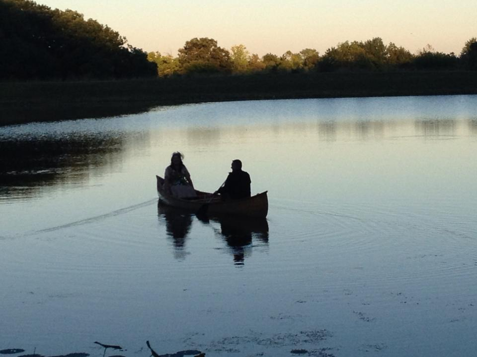Couple in the boat at dusk by the Moon Pic.jpg