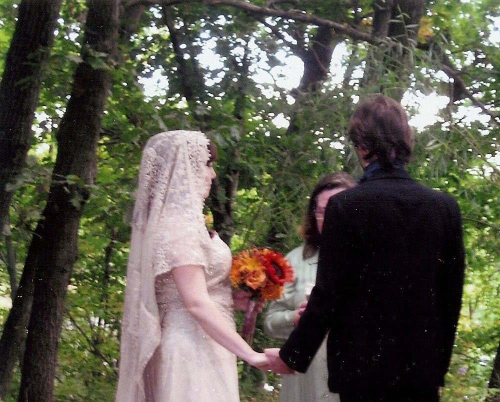 Laura & Craig - Couple holding hands in ivory lace dress.jpg