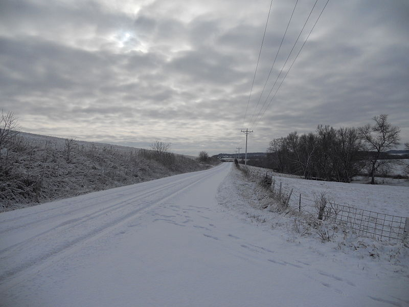 Snowy road in Iowa, by Jsayre64 (Own work) [CC BY-SA 3.0 (http://creativecommons.org/licenses/by-sa/3.0)], via Wikimedia Commons