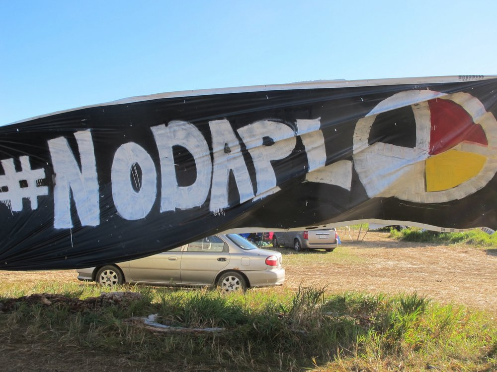 A BANNER PROTESTING THE DAKOTA ACCESS PIPELINE HANGS NEAR NORTH DAKOTA'S STANDING ROCK SIOUX RESERVATION ON FRIDAY, SEPT. 9, 2016. CREDIT: AP PHOTO/JAMES MACPHERSON