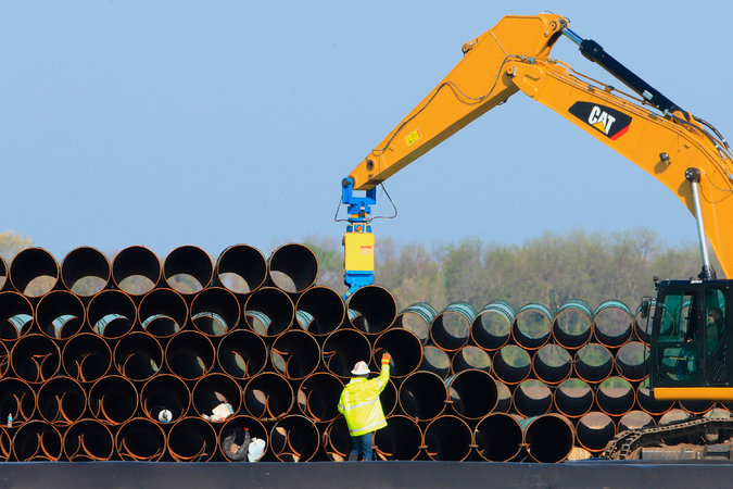 Pipes being stacked for the Dakota Access oil pipeline last year at a staging site in Worthing, S.D. Credit Nati Harnik/Associated Press