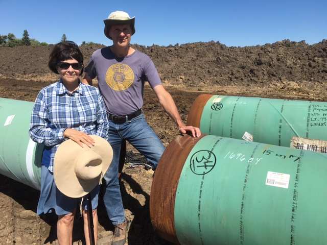 Iowa landowner Cyndy Coppola and Bold Iowa director Ed Fallon on Cyndy's land before the Dakota Access Pipeline construction was finished (Bold Iowa)