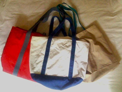 Three colorful cloth bags