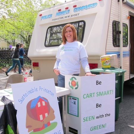 Township recycling coordinator wearing recycling team teeshirt at Sustainable Princeton's Communiversity table