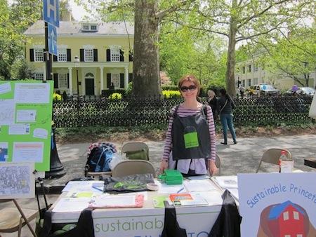 Volunteer behind Sustainable Princeton table at Communiversity