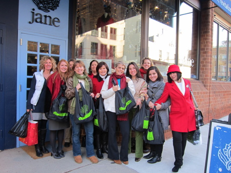 A group of shoppers with Princeton Shops Sustainably resuable bags in front of jane store