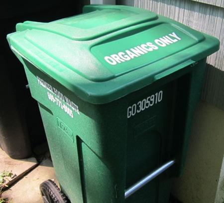 green plastic waste bin