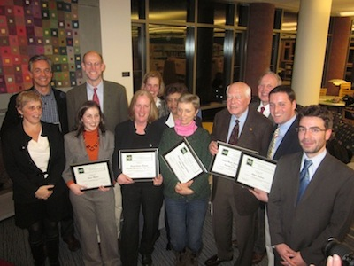 group of people holding award plaques
