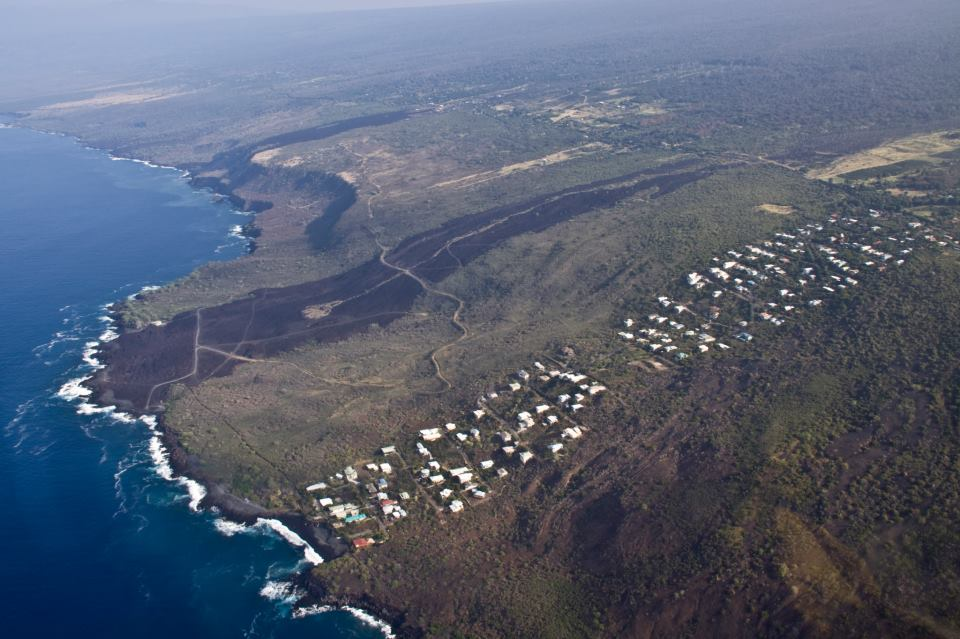 Housing spill, a.k.a Disaster Contextualism. A subdivision mimics the morphology of an adjacent lava flow. Spotted while flying over the big island of Hawaii.