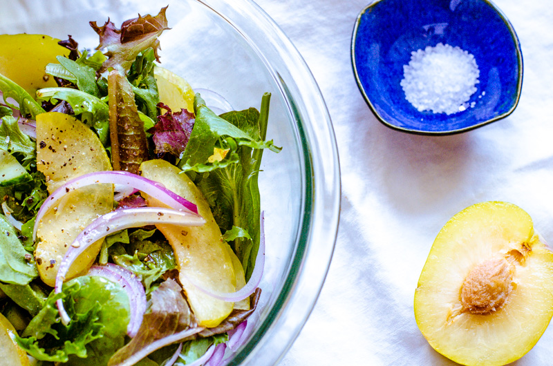 pluot and onion salad with honey brown mustard vinaigrette