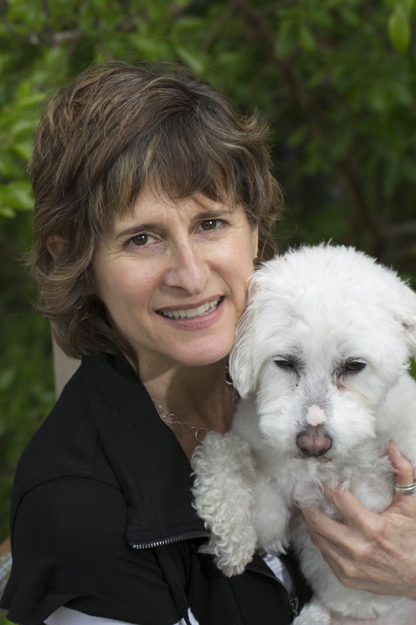 Fun headshot of Claudia Braun and her dog.  © Clare Britt Photo