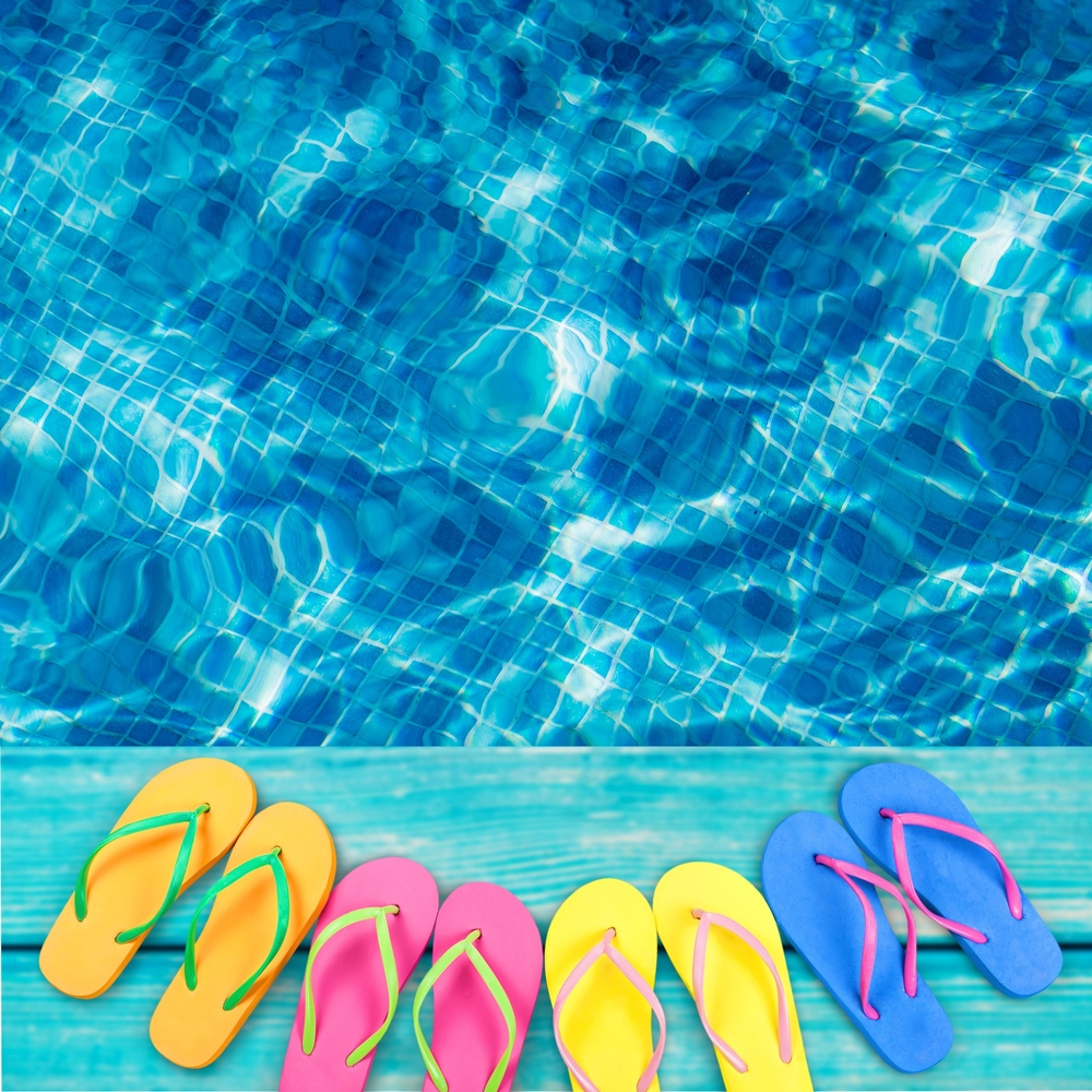 Flip flops next to a pool in The Woodlands, Texas
