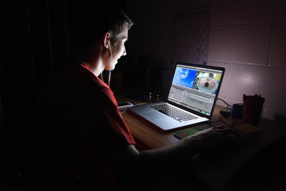 TJ-laptop-in darkedited.jpg