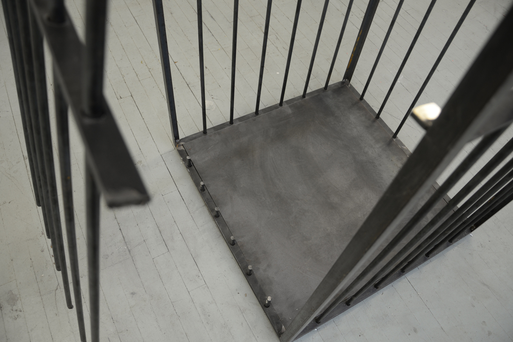 "Cage #1 (detail). Mill Finished Steel and Neodymium Magnets (used for performance and cut open by the NYPD on October 25, 2015) 72.5 x 31"" x 31"" inches."