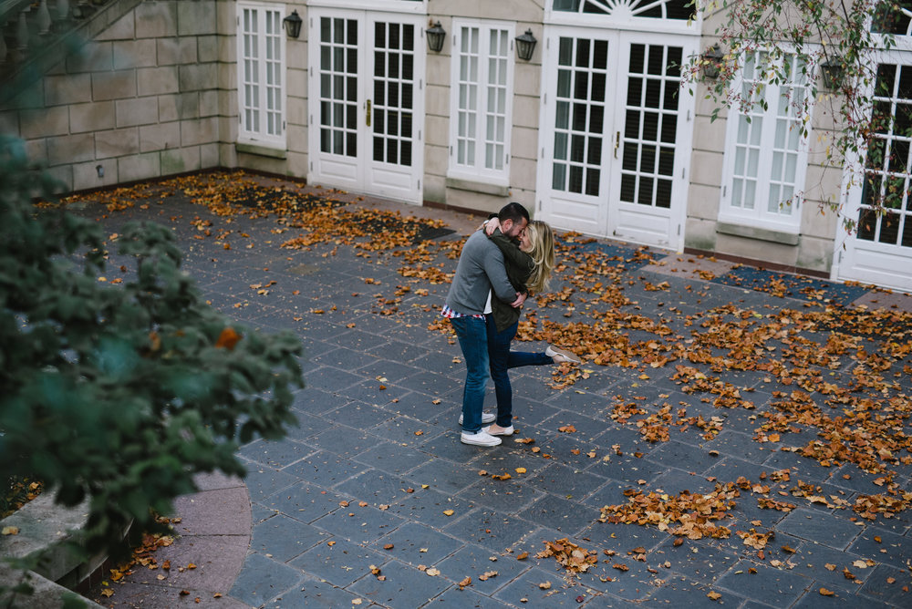 dancing in the courtyard of dumbarton oaks for engagement photos