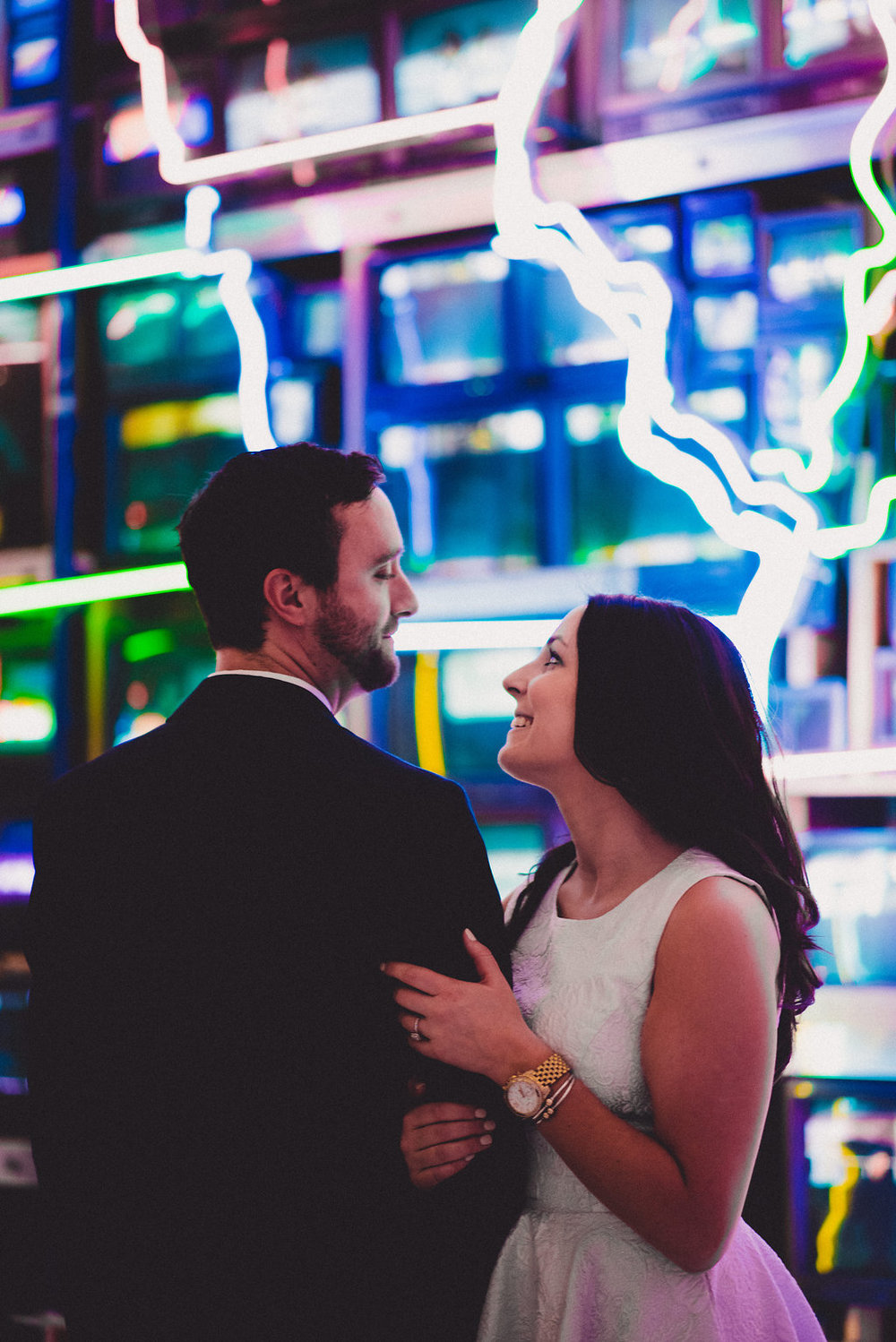 engagement in front of the neon united states at the american art museum