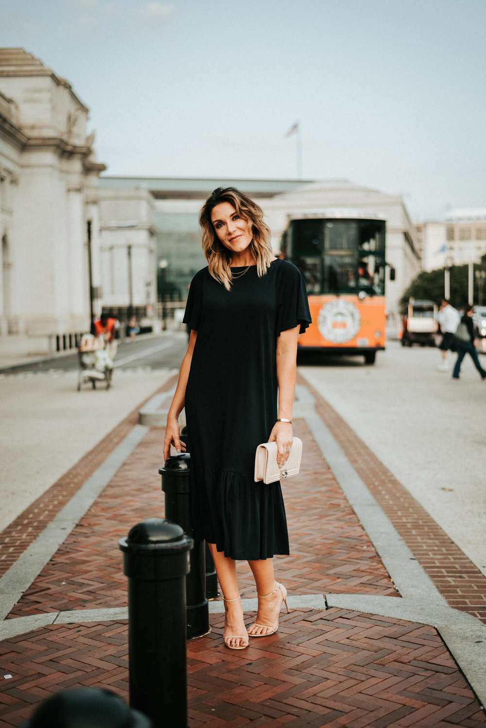 beautiful woman stands outside union station in downtown washington DC