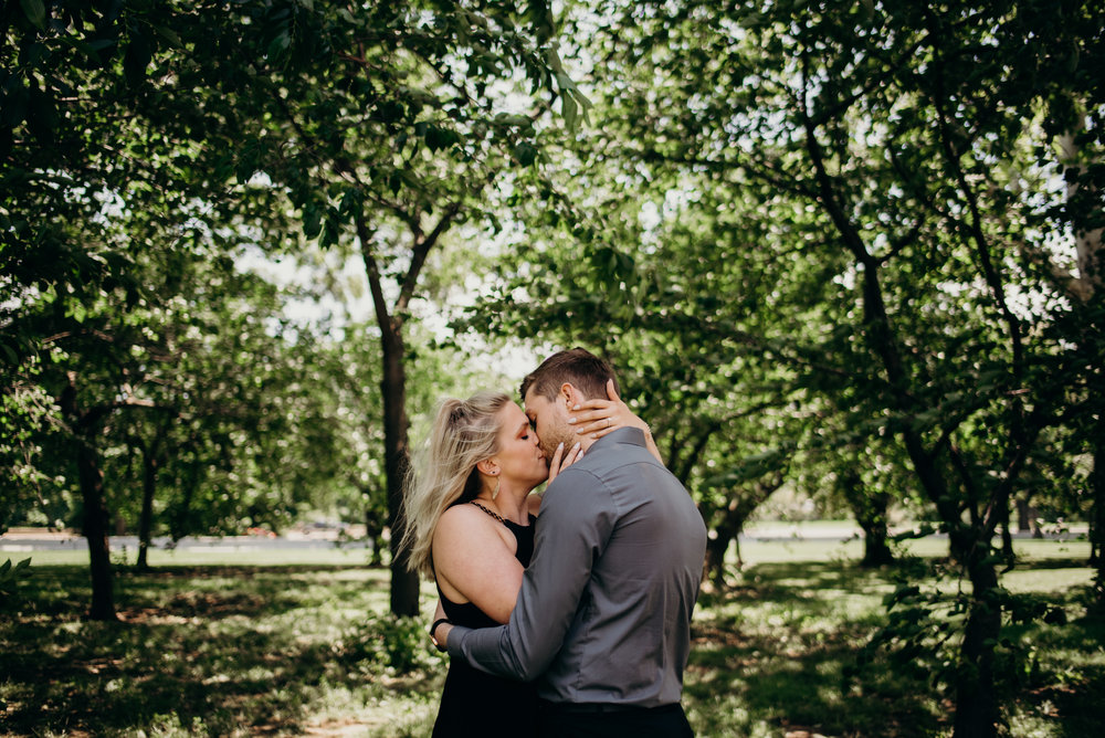 engagement session kissing among trees