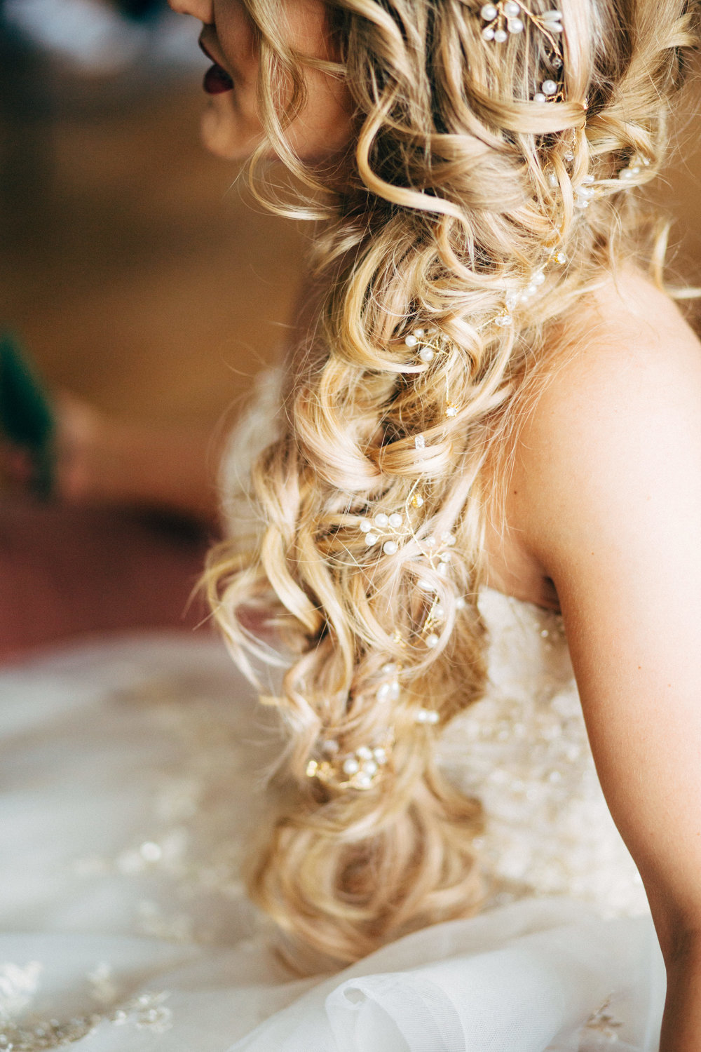 profile of bride with mermaid hair before wedding