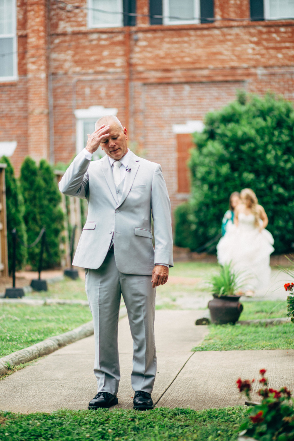 Father of the bride waiting to see his daughter in her wedding dress