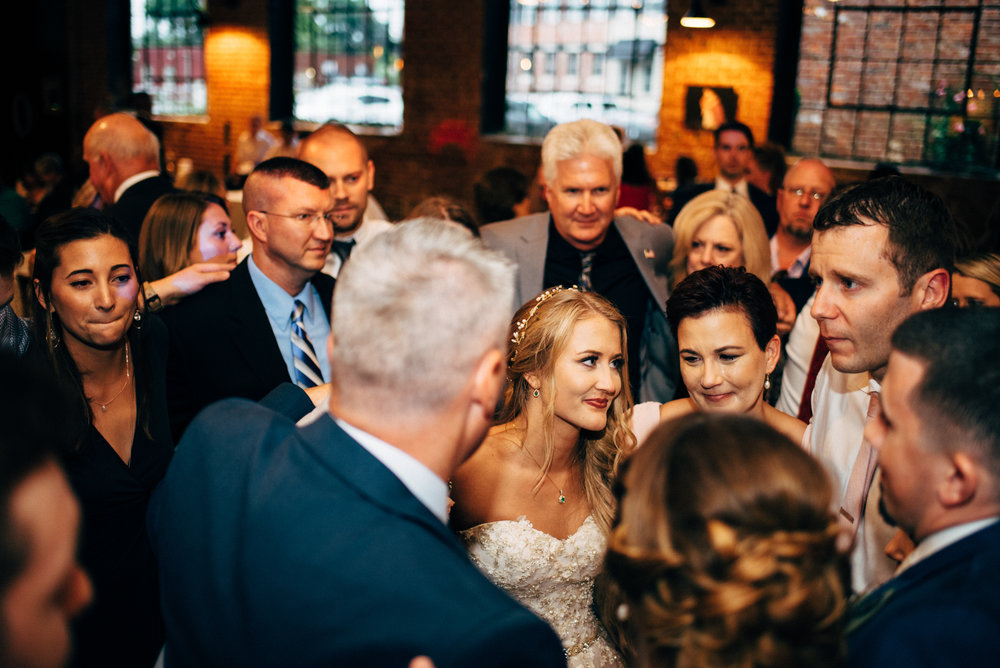 circle of family and friends with the bride at the Inn at the Old Silk Mill