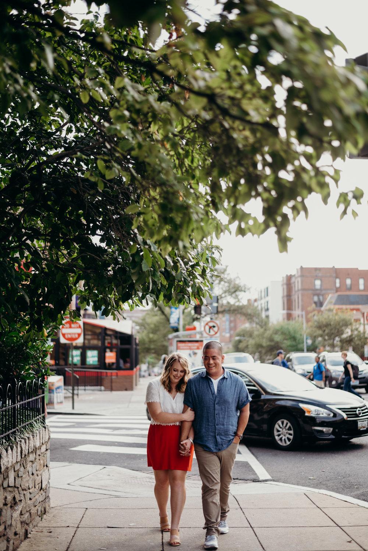 engaged couple walking down sidewalk in  Washington, D.C.