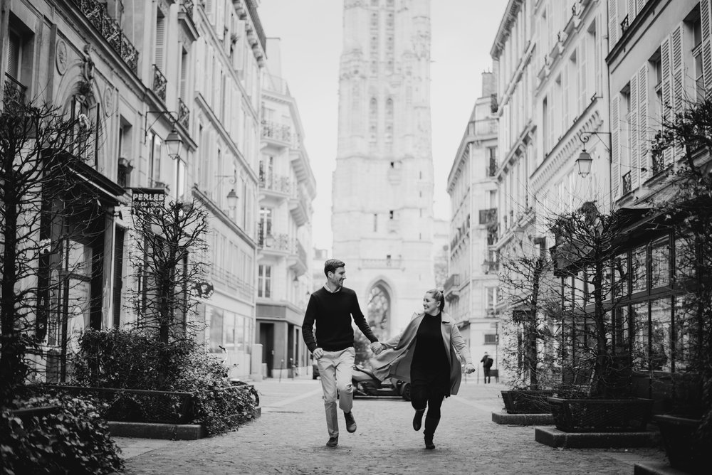 newlyweds running through Paris Streets on their honeymoon