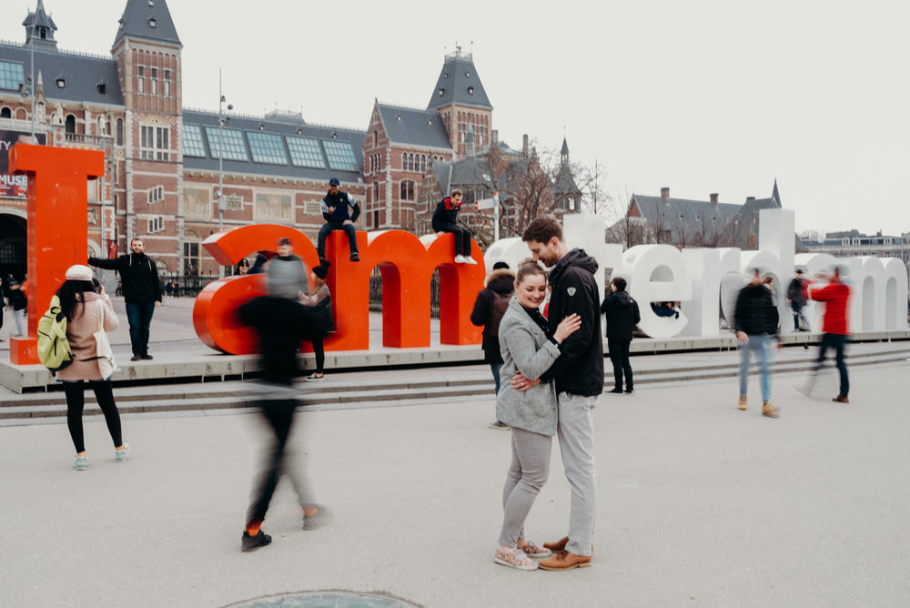 honeymoon photo shoot in Amsterdam next to sign